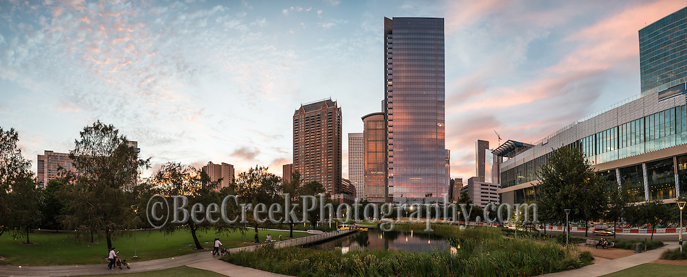 A little later and more drama with the colors in the sky reflecting back on the high rise in the Discovery Green park in this panorama.  The lake pick up some of the color from the skyscraper in the skyline. Watermark will not appear on image