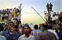 Abu Graibh penitentiary, near Baghdad, October 20, 2002.Tens of thousands of prisoners are amnistied by president Saddam Hussein and are released 2 hours after the official announcement..At the prisons' gate, an countless crowd eagerly awaits liberated relatives and friends.