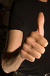 Uri Geller at home Berkshire England 2008. Thumbs up.