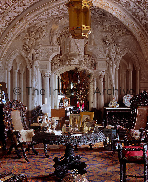 The back wall of the Arab Room features trompe l'oeil neo-Manueline architecture and the room is furnished with ornately carved Indo-Portuguese furniture