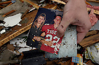 BLOUNTSTOWN, FL. 9/16/04-Devon Rabon, age 19, holds a photo on Thursday showing he and his mother Mary Marshall who was killed late Wednesday after a tornado spawned by Hurricane Ivan destroyed their mobile home near Blountstown. Rabon, who stayed with his mother on weekends, was at the site Thursday recovering what he could from the wreckage of their home. COLIN HACKLEY PHOTO