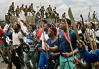 Police watch an Inkatha Freedom Party (IFP) march to a rally in Soweto.