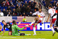 Thierry Henry (14) of the New York Red Bulls watches a shot go wide as D. C. United goalkeeper Bill Hamid (28) defends during the second leg of the MLS Eastern Conference Semifinals at Red Bull Arena in Harrison, NJ, on November 8, 2012.