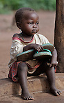 A girl displaced by war sits in the Makpandu refugee camp in Southern Sudan, 44 km north of Yambio, where more that 4,000 people took refuge in late 2008 when the Lord's Resistance Army attacked their communities inside the Democratic Republic of the Congo. Attacks by the LRA inside Southern Sudan and in the neighboring DRC and Central African Republic have displaced tens of thousands of people, and many worry the attacks will increase as the government in Khartoum uses the LRA to destabilize Southern Sudan, where people are scheduled to vote on independence in January 2011. Catholic pastoral workers have accompanied the people of this camp from the beginning.