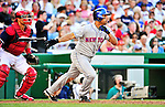3 July 2010: New York Mets' second baseman Alex Cora hits a triple against the Washington Nationals at Nationals Park in Washington, DC. The Nationals rallied in the bottom of the 9th to defeat the Mets 6-5 in the third game of their 4-game series. Mandatory Credit: Ed Wolfstein Photo