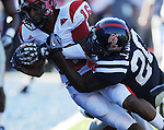 Jacksonville State's Alan Bonner (16) scores a touchdown as Mississippi's Johnny Brown (20) defends at Vaught-Hemingway Stadium in Oxford, Miss. on Saturday, September 4, 2010. Jacksonville State won 49-48 in double overtime. (AP Photo/Oxford Eagle, Bruce Newman)