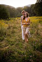 Young couple walking through an open field