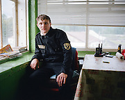 Dmitry, a museum security guard, in the former guardhouse. Perm province, Russia 2015