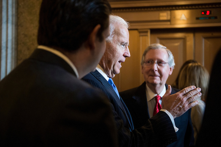 UNITED STATES - JANUARY 3: Vice President Joe Biden, center, speaks with Senate Minority Leader Mitch McConnell, R-Ky., right, and Sen.-elect Ted Cruz, R-Texas, left, as the arrive to greet the arrival of  Sen. Mark Kirk, R-Ill., to the Senate on Thursday, Jan. 3, 2013. Sen. Kirk, who suffered a stroke, made his return to the Senate by walking up the Senate steps for the start of the 113th Congress. (Photo By Bill Clark/CQ Roll Call)