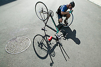 2 July 2005 - Jersey City, NJ, USA - A rider changes a tyre - a required exercise - in a qualifying race for the 13th annual cycle messenger world championships, Jersey City, USA, July 2nd 2005. More than 700 riders from all over the world took part in the 4-day competition which carries event based on the daily work of a city bike messenger.