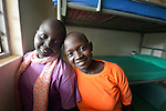 Two students pose in the dormitory of the Loreto Secondary School in Rumbek, South Sudan. The school is run by the Institute for the Blessed Virgin Mary--the Loreto Sisters--of Ireland.