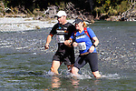NELSON LAKES, NEW ZEALAND - APRIL 18:  Mark and Cindy Steele cross the Travers River during the 2015 Alpine Lodge Loop The Lake trail run at Lake Rotoiti on April 18 16, 2015 in Nelson, New Zealand. (Photo by Marc Palmano/Shuttersport Limited)