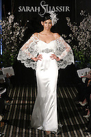 Model walks runway in a Serene wedding dress by Sarah Jassir, for the Sarah Jassir Fall 2011 - Desire bridal collection.