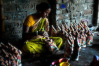 Jyotirmoyee Pal (37), working in her factory, She is a potter and produces colourful clay dolls. She expanded her business by taking micro credits from Bandhan. Ghurni village, Krishna Nagar, West Bengal, India. Arindam Mukherjee.