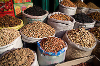 Spices, nuts, and dried fruit for sale on the streets in Urumqi, Xinjiang, China.