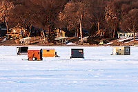 Ice fishing houses on frozen Spring Lake in Scott County, Minnesota