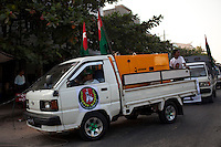 A convoy of vehicles campaigning for the government-backed USDP (Union Solidarity and Development Party) in the old capital Rangoon (Yangon) in the lead up to Burma's first multi-party election since 1990. However, the main pro-democracy party, the NLD (National League for Democracy), boycotted the poll and other opposition groups have alleged widespread voting fraud.