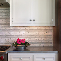 Bamboo marble mosaic backsplash shown in Bardiglio and Calacatta Tia.
