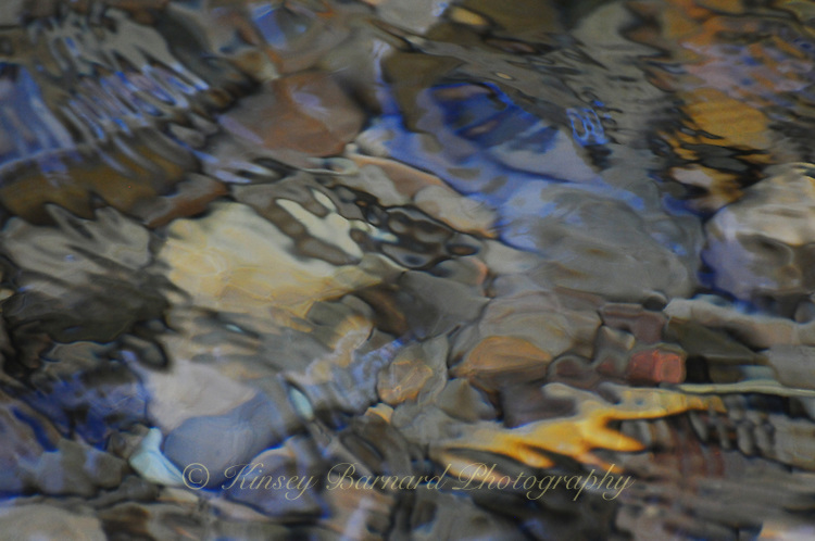 &quot;RIVER MOSAIC&quot;<br /> <br /> Soft, colorful abstract images of stones and pebbles beneath the cool waters of the Tobacco River in Montana. ORIGINAL 24 X 36 GALLERY WRAPPED CANVAS SIGNED BY THE ARTIST $2,500. CONTACT FOR AVAILABILITY.