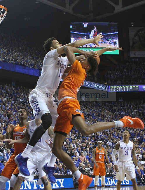 UK forward Skal Labissiere (1) fouls Florida forward Devin Robinson as he goes up for a layup during the UK Men's Basketball vs. Florida Gators game at Rupp Arena. Saturday, February 6, 2016 in Lexington, Ky. UK defeated Florida 80 - 61
