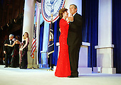United States President George W. Bush and First Lady Laura Bush dance at one of nine inaugural balls in Washington, D.C. as their daughter Jenna (black dress) watches, on January 20, 2001..Credit: Robert Trippett / Pool via CNP.
