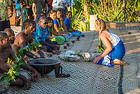 Namotu Island Resort, Nadi, Fiji (Saturday, May 28 2016): Courtney Conlogue (USA)  presenting the chief with a gift of Kava root. The Opening Ceremony of the 2016 Fiji Women's Pro was held today on Tavarua Is.There was a traditional welcome with a kava Ceremony and dancing. Girls from the different countries represented in the contest present the Chief with Kava root. Photo: joliphotos.com
