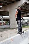 Andrew Speir, a member of the Black Bloc anarchist group,gets a higher vantage point of his groups as they march through the streets during the 2012 Republican National Convention on August 27, 2012 in Tampa, Fla.