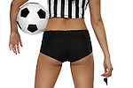 Sexy woman in referee outfit with a soccer ball. Isolated on white background with clipping path.