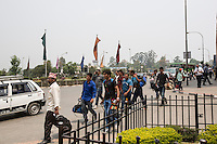 Nepal - Kathmandu - Workers arriving at the International airport of Kathmandu with a small luggage containing all their belongings for the two years they will spend abroad before coming back home. According to UN figures, 7,2 million Nepalis work abroad (4 millions of them in India). Half of them are undocumented, 1700 migrant workers leave Nepal every day, 2/3 dead bodies arrive at Kathmandu airport every day. According to the World Bank, in 2013 Nepal received more than 5 billion USD in remittances from abroad. This constitutes 24.7 percent of the GDP, the third highest percentage in the world after Tajikistan and Kyrgyzstan. A third of all Nepali households, and 35% of rural households, have at least one member working and living abroad. 24.8 percent of Nepalis still live under the poverty line. Nepali GDP per capita (PPP) stands at 1,102 USD, the twentieth lowest in the world. Since 1971, Nepal has been classified as one of the 48 least developed countries by the UN.