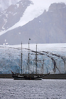 Three masted wooden sailing schooner transferring tourists to glacier Kongsfjord Ny Alesund Spitsbergen Barents sea North east Atlantic