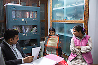 Brinda (center) is coached by the Guria lawyer team in preparation for her final witness statement in the Guria office in Varanasi, Uttar Pradesh, India on 22 November 2013. She is one of the 57 underaged and trafficked girls rescued from the Shivdaspur red light area in Varanasi, who has been fighting a court case against her traffickers and brothel owners for the past 8 years.