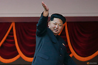 North Korean leader Kim Jong Un waves to the crowd during the parade celebrating the 70th anniversary of the founding of the ruling Workers' Party of Korea, in Pyongyang October 10, 2015. Isolated North Korea marked the 70th anniversary of its ruling Workers' Party on Saturday with a massive military parade overseen by leader Kim Jong Un, who said his country was ready to fight any war waged by the United States.   REUTERS/Damir Sagolj