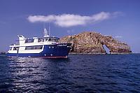 Custom-built live-aboard dive vessel, Ocean Rover  cruising among rugged limestone islets in Myanmar's Mergui Archipelago.  Stewart Island, a.k.a. Bo Wei Is., Mergui Archipelago, Myanmar / Burma, Andaman Sea
