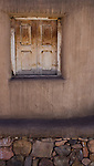 Adobe building and wood window (Santa Fe, New Mexico).