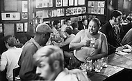 Manhattan, New York City, NY. August 1970.  <br /> Men drinking ale at McSorley's Old Ale House in Manhattan in 1970. McSorley's was New York City's oldest bar and it refused female patrons before 1970.