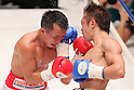 (L to R) Pornsawan Porpramook (THA), Akira Yaegashi (JPN), October 24, 2011 - Boxing : Akira Yaegashi of Japan hits Pornsawan Porpramook of Thailand during the WBA Minimum weight title bout at Korakuen, Tokyo, Japan. Akira Yaegashi won by TKO after the fight was stopped in the tenth round. (Photo by Yusuke Nakanishi/AFLO SPORT) [1090].