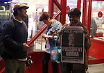 A woman holds open the front page of the New York Daily News showing President-elect Barack Obama on election day early Wednesday, Nov. 5, 2008  at Times square in New York. Photo by Eyal Warshavsky .