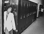 A Mumford High School student hangs out in her locker in Detroit, MI in 1981.