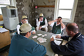 The Churchill Downs start crew play a friendly game of cards between races. Start crews work seasonally and are busy during Triple Crown season which includes the Kentucky Derby at Churchill Downs in Louisville, Kentucky.