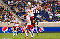 Heath Pearce (3) of the New York Red Bulls and Jose Erick Correa (27) of CD Chivas USA go up for a header. The New York Red Bulls and CD Chivas USA played to a 1-1 tie during a Major League Soccer (MLS) match at Red Bull Arena in Harrison, NJ, on May 23, 2012.
