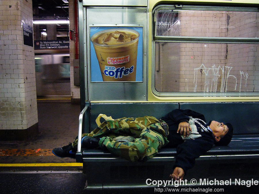 NEW YORK -- MAY 20, 2006:  A man sleeps on the NYC subway on May 20, 2006 in New York City.  (PHOTOGRAPH BY MICHAEL NAGLE)
