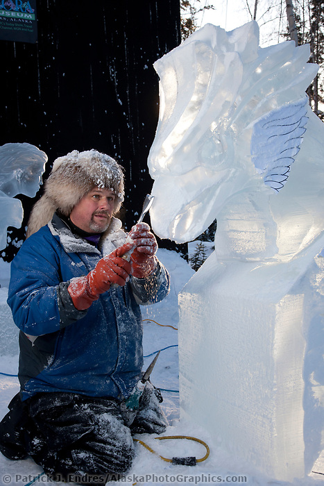 "Jeff Stahl, USA, carves on the multi block sculpture titled ""Guardian Angel of Mischief"" for the 2009 World Ice Art Championships in Fairbanks, Alaska. Team members: Heather Brice, Kevin Gregory, Jeff Stahl, Steve Cox"
