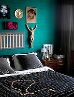 Lines of white thread sewn into the bed cover adds texture to the bold blocks of colour in the bedroom
