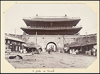BNPS.co.uk (01202 558833)<br /> Pic: Sothebys/BNPS<br /> <br /> City gate into Seoul.<br /> <br /> Unseen pictures from the days of Empire - A British admiral's stunning collection of photos from his time in the Far East have been unearthed after 110 years.<br /> <br /> The fascinating photographs were compiled by Admiral Sir Arthur Moore during his service as Commander-in-Chief of the China Station between 1906 and 1908. <br /> <br /> They cover Adm Moore's travels by ship and boat in China, Korea and Thailand and his interest in the places and people he encountered. <br /> <br /> The locations include scenes along the Yangtze River, Hong Kong, Bangkok, Peking, Shanghai and Seoul.