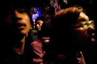 Punk fans watch a band perform during a concert at Castle Bar in Nanjing, China.