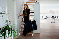 Cecilie carries her suitcase as she prepeares to go to Kathmandu, at her home in Gentofte. 19 month old Victoria (formerly named Ghane) was born with hydrocephalus and was left abandoned. Cecilie Hansen was so moved by the story of Ghane she read in a Danish newspaper that she decided to fly to Kathmandu to try to assist her and show her the love of another human being; Cecilie eventually became her legal guardian. Victoria died on November 19 2010 from heart failure.