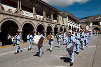 Sinfonia Huamanga, a band of musicians, parade in downtown Ayacucho Saturday before Easter.