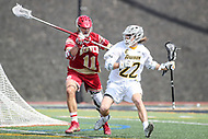 Towson, MD - March 25, 2017: Towson Tigers Ryan Drenner (22) is being defended by Denver Pioneers Jake Nolan (11) during game between Towson and Denver at  Minnegan Field at Johnny Unitas Stadium  in Towson, MD. March 25, 2017.  (Photo by Elliott Brown/Media Images International)