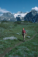Banff National Park, Canadian Rockies, AB, Alberta, Canada - Woman Hiker hiking in Larch Valley, Rocky Mountains, Summer Scenic