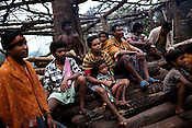 People from the Dongria Kondh tribes gather around at a common place in their village Salpajola in the Niyamgiri Hills. Niyamgiri hills, its flaura and fauna and the tribes come under direct threat of extinction because of expansion and mining plans of the aluminium company, Vedanta.